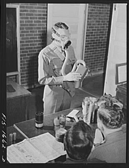 Captain William W. Kitchen instructing a U.S. Army chaplain school class in gas warfare and the use of gas masks. Fort Benjamin Harrison, Indiana