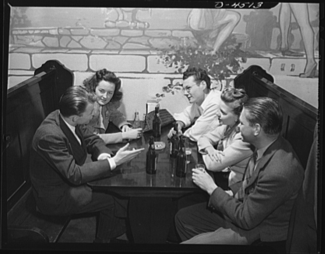 Car pooling at Lockheed Vega. After a day's work, the average rider group stops at a tavern on the way home. Most have beer. Mary sticks to Coke. All listen to Jerry telling what appears to be an interesting story