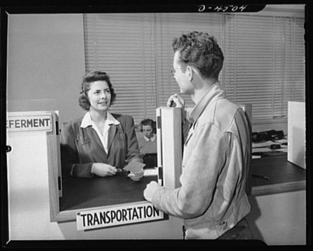 Car pooling at Lockheed Vega. Don hands in his card at the transportation desk