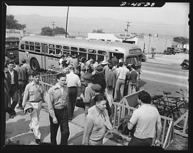 Car pooling at Lockheed Vega. Outside the plant gate, they wait for busses like this one. Eighty-four busses of this type have been placed in service in about six weeks, and more are being added continually. Busses will make the circuit of all the gates, stopping a few minutes at each, then making a straight run to the railhead