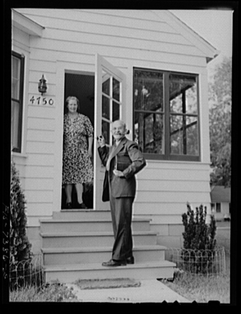 Cass Lake, near Pontiac, Michigan. Karl Axel Westerberg bidding his wife goodbye before leaving for the day's work at the Johansson gauge division of the Ford Motor Company. Karl Westerberg and his son, Eric, built their pleasant home in spare hours after work