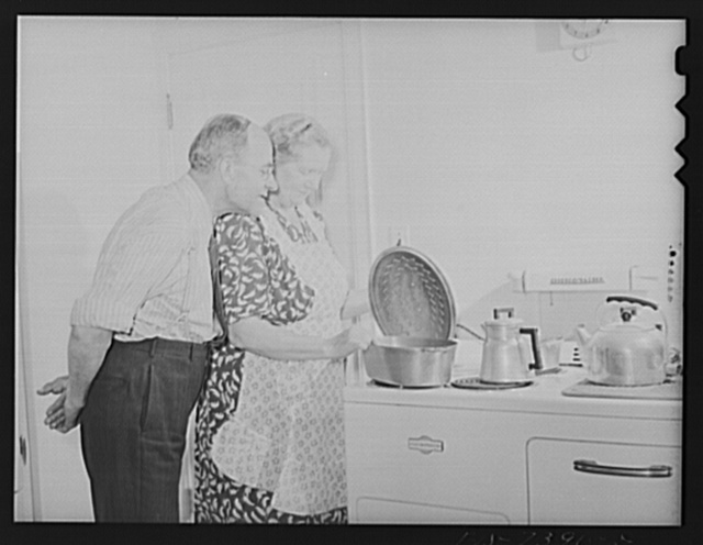 Cass Lake, near Pontiac, Michigan. Mr. Westerberg inspecting Mrs. Westerberg's dinner preparation of Swedish dishes. The Westerbergs came from Eskilstuna, Sweden in 1924