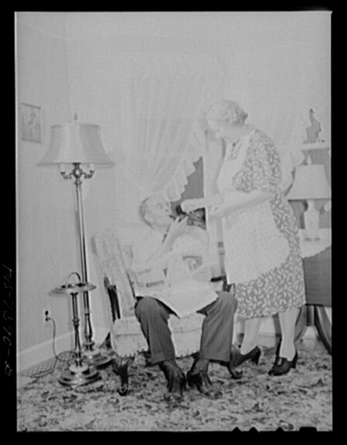 Cass Lake, near Pontiac, Michigan. Mrs. Westerberg lighting a match for her husband's pipe as he relaxes after a day at the Johansson gauge division of the Ford Motor Company where he is foreman of the rough stock department