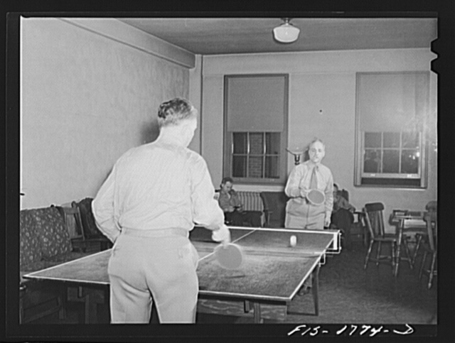Chaplain (Major) P.M. Hickcox, and Chaplain (Major) P.L. Cronin, playing a game of ping-pong in the recreation hall of the U.S. Army chaplain school. Fort Benjamin Harrison, Indiana
