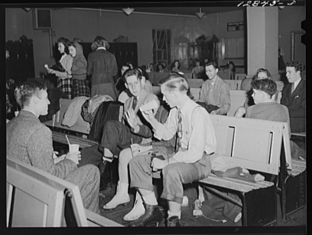 Chevy Chase Ice Palace, Washington. D.C. Skaters sitting down enjoying refreshments