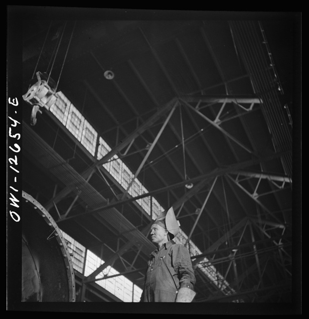 Chicago, Illinois. A welder at the Chicago and Northwestern Railroad shops