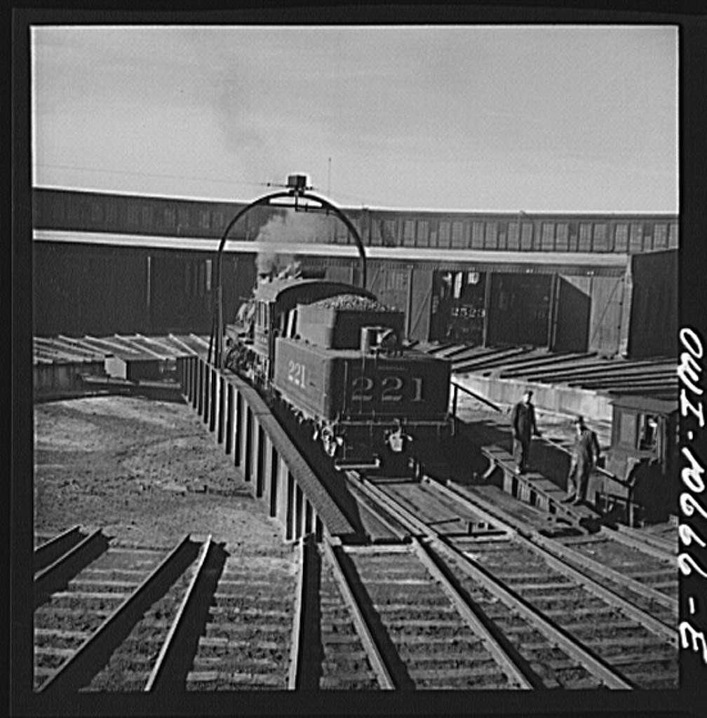Chicago, Illinois. An engine on the turntable at the roundhouse at an Illinois Central Railroad yard