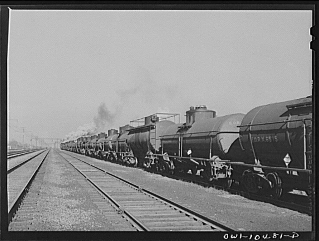 Chicago, Illinois. An oil train from the Southwest leaves an Illinois Central Railroad yard for the Pennsylvania railroad to be sent on to the east