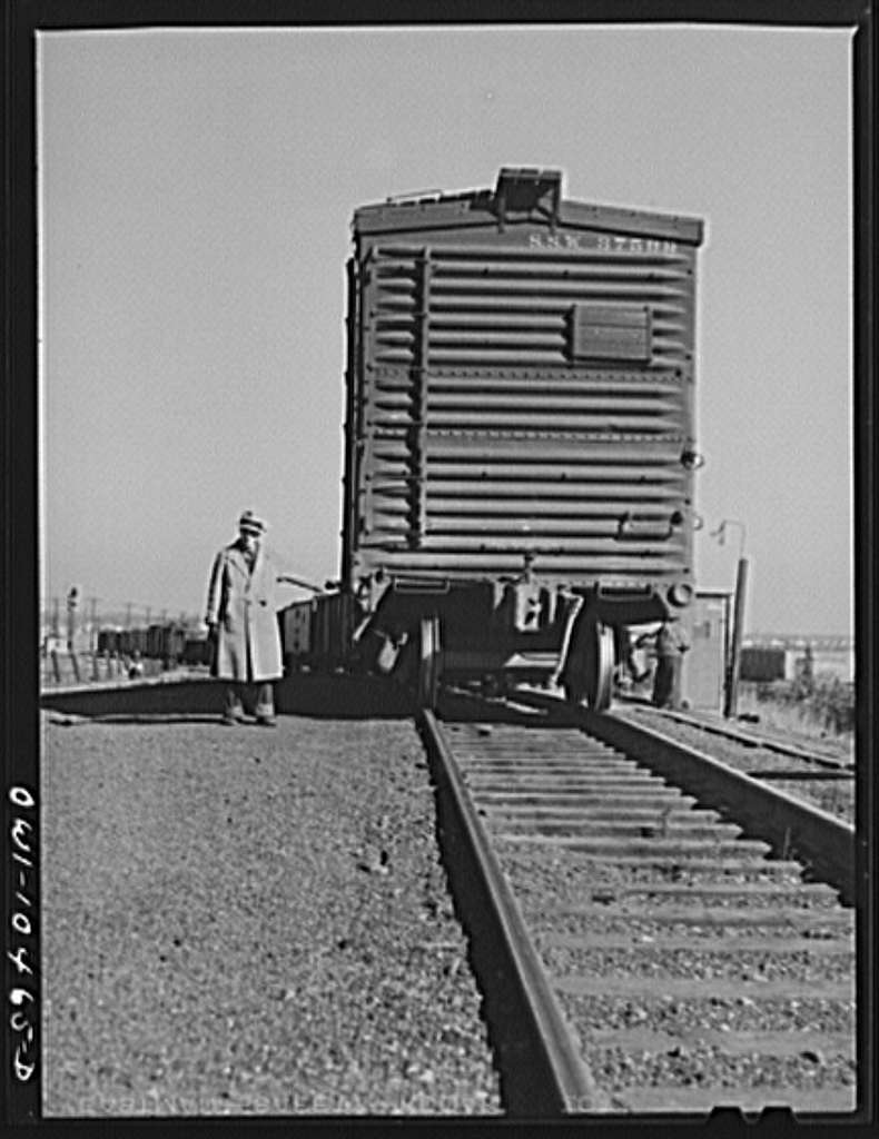 Chicago, Illinois. Car coming up over the south hump at an Illinois Central Railroad yard