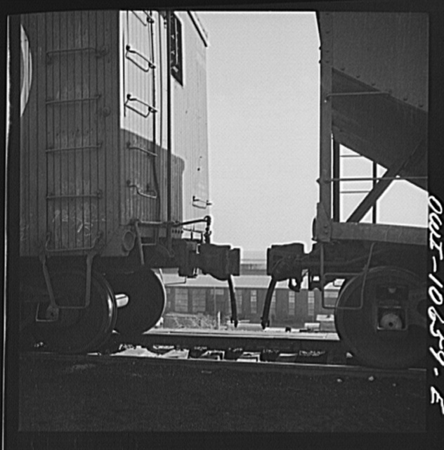Chicago, Illinois. Cars are uncoupled at the top of the hump and roll down by gravity at an Illinois Central Railroad yard to the classification yards