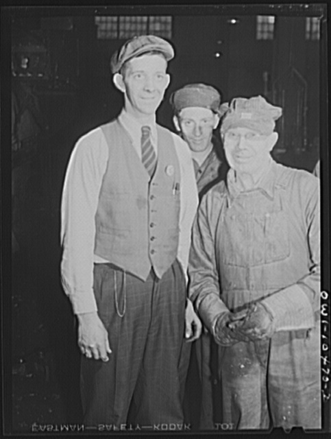 Chicago, Illinois. Engine foreman (left) and two workmen at the roundhouse at an Illinois Central Railroad yard