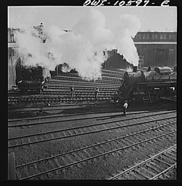 Chicago, Illinois. Engine going into its stall for repairs at the roundhouse at an Illinois railroad yard