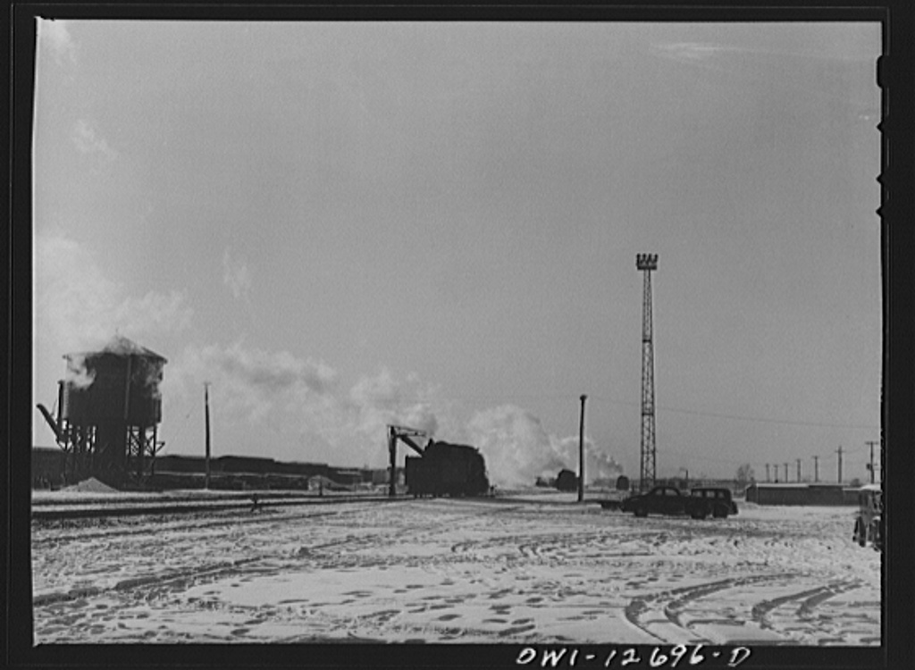 Chicago, Illinois, Engine taking on water at a Chicago and Northwestern Railroad yard