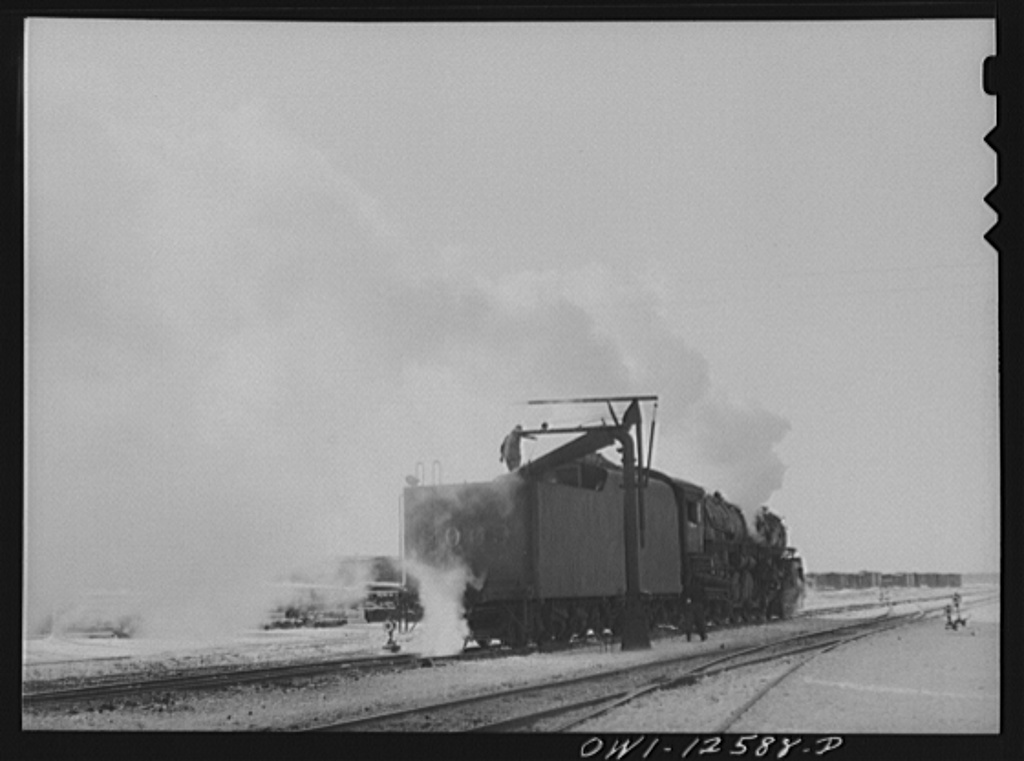 Chicago, Illinois. Engine taking on water before going out on the road at a yard of the Chicago and Northwestern Railroad