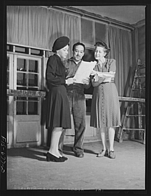 Chicago, Illinois. Good Sheperd Community Center. Two of the actors with Mr. Langston Hughes discussing the script of a new play during rehearsal