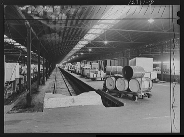 Chicago, Illinois. Goods of every description lined up on loading platforms at a freight house at a Chicago and Northwestern Railroad yard