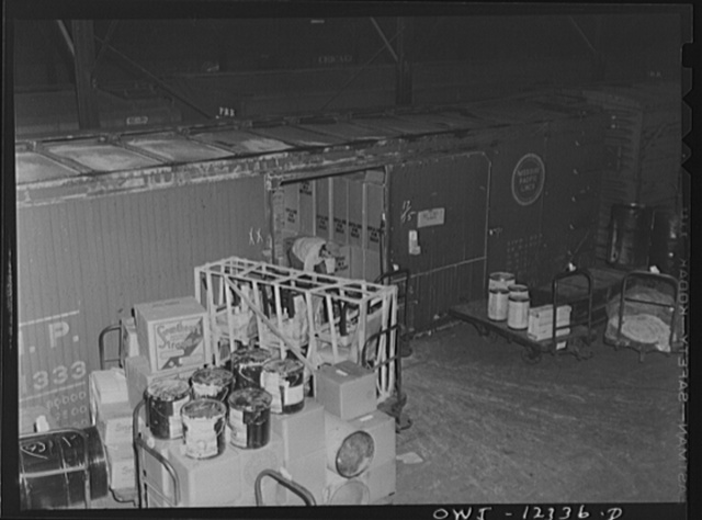Chicago, Illinois. Goods on the loading platform at the freight house at a Chicago and Northwestern Railroad yard