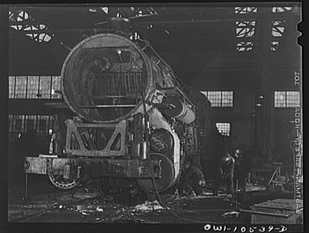 Chicago, Illinois. In the roundhouse at an Illinois Central Railroad yard. This switch engine is being converted into a road engine