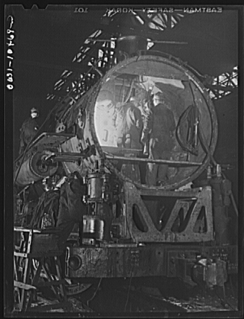 Chicago, Illinois. In the roundhouse at an Illinois Central Railroad yard. This former switching engine is being rebuilt for use on the road