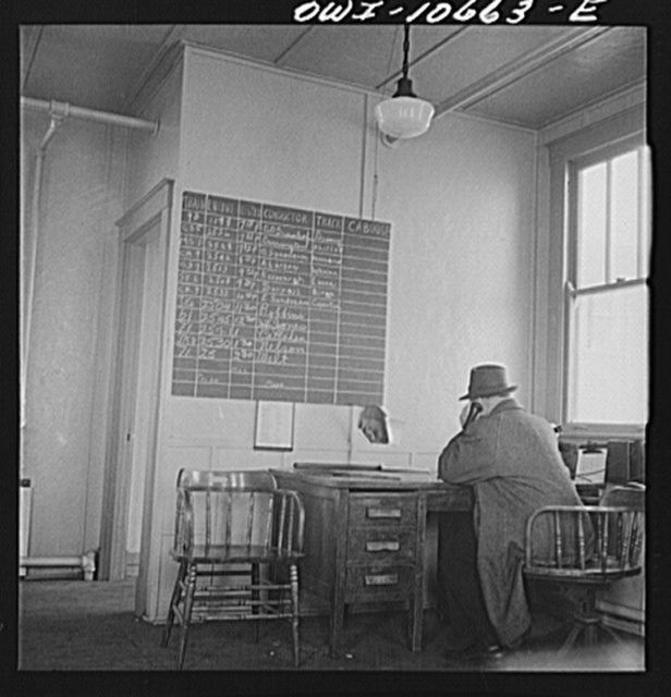 Chicago, Illinois. In the yardmaster's office at the south classification yard at an Illinois Central Railroad yard