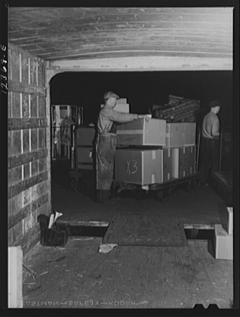 Chicago, Illinois. Loading goods into a truck trailer at a freight house at a Chicago and Northwestern Railroad yard