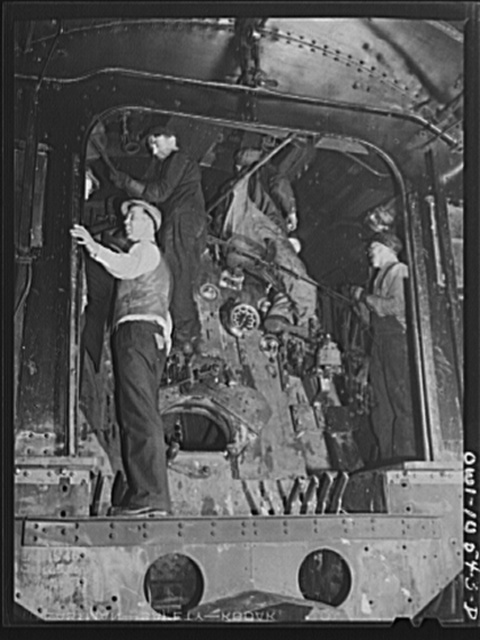 Chicago, Illinois. Locomotive repair in roundhouse at an Illinois Central Railroad yard