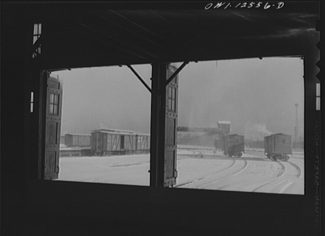 Chicago, Illinois. Looking out toward the icehouse from the freighthouse at a yard of the Chicago and Northwestern Railroad