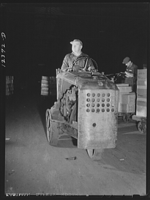 """Chicago, Illinois. One of the """"motors"""" used to haul dollies loaded with goods around the freight house at a Chicago and Northwestern Railroad yard"""