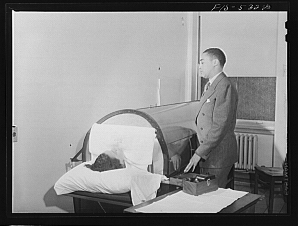 Chicago, Illinois. Provident Hospital. Dr. Harold Thatcher administering fever therapy to a patient