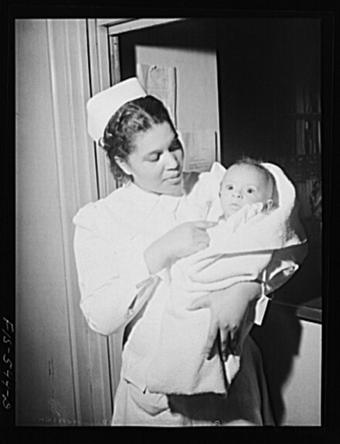 Chicago, Illinois. Provident Hospital. Miss Irene Hill, nurse technician, taking baby to be x-rayed