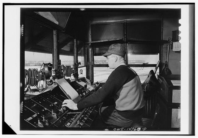 Chicago, Illinois. Retarder operator in his tower at the hump in the Chicago and Northwestern classification yard
