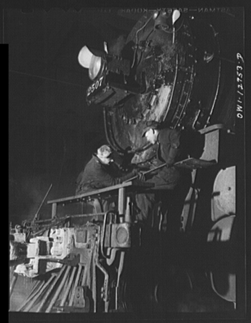 Chicago, Illinois. Servicing an engine at the roundhouse at a Chicago and Northwestern Railroad yard