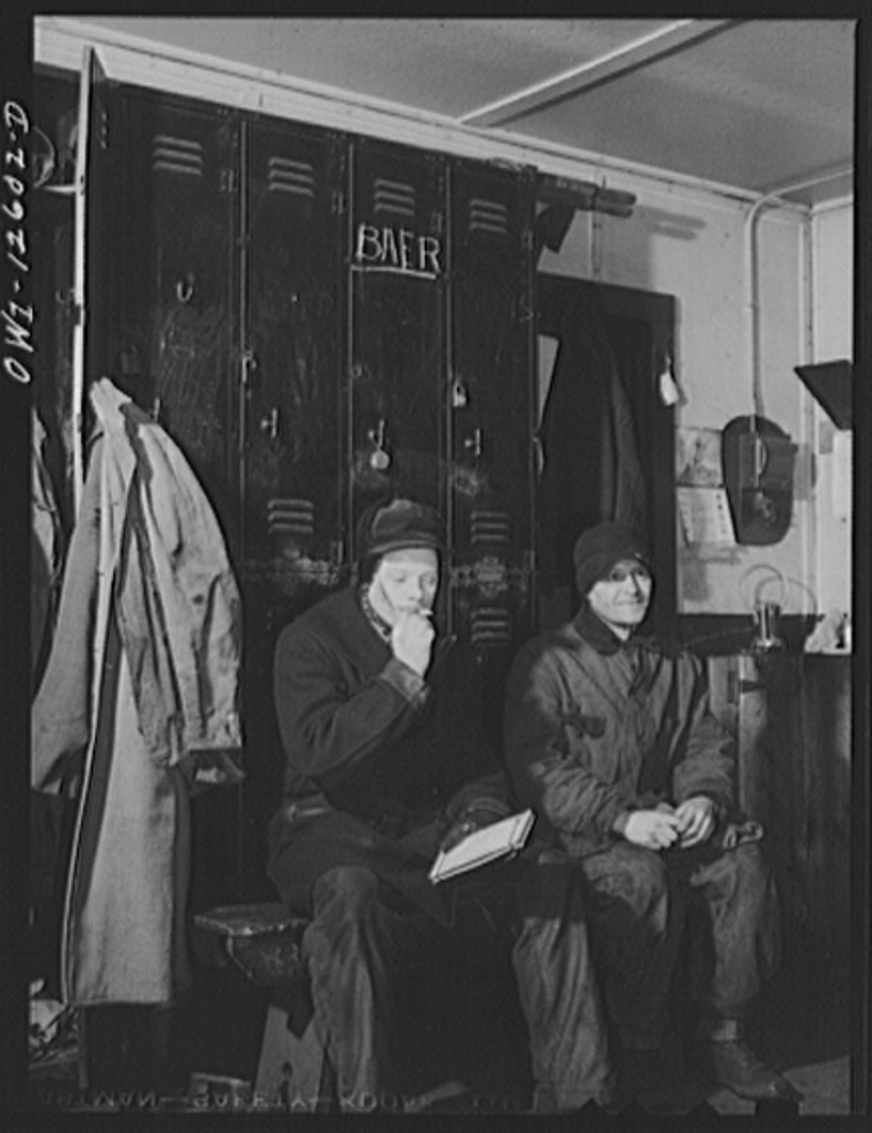 Chicago, Illinois. Switchmen resting between trains in the yard office in a Chicago and Northwestern Railroad yard