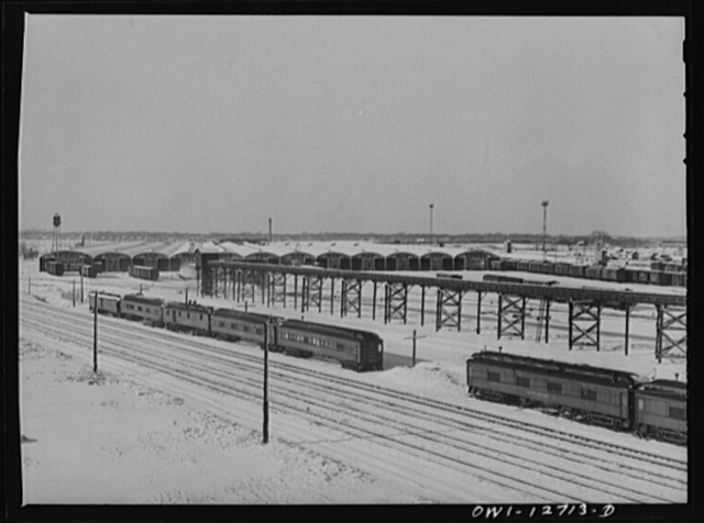 Chicago, Illinois. The freight house at a Chicago and Northwestern Railroad yard. In the foreground are old cars used as living quarters for some yard workers and itinerant help