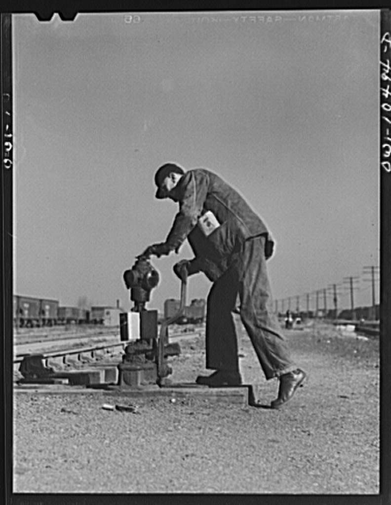 Chicago, Illinois. Throwing a switch after an Illinois Central Railroad train has gone by