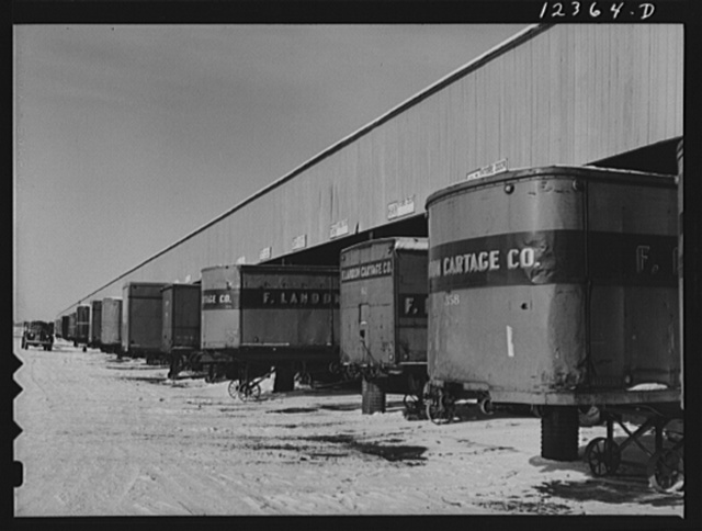 Chicago, Illinois. Truck trailers line up at a freight house to load and unload goods from the Chicago and Northwestern Railroad