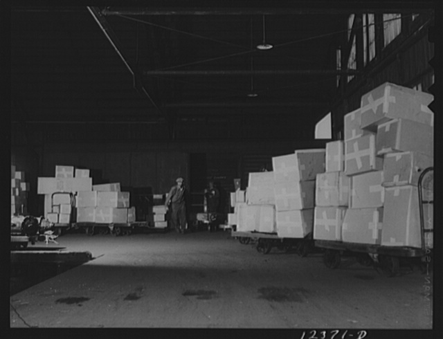 Chicago, Illinois. Unloading cars in the freight house at a Chicago and Northwestern Railroad yard