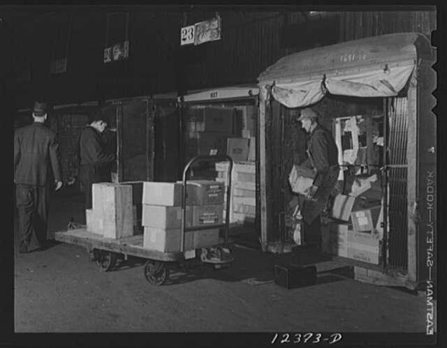 Chicago, Illinois. Unloading truck trailers in the freight house at a Chicago and Northwestern Railroad yard