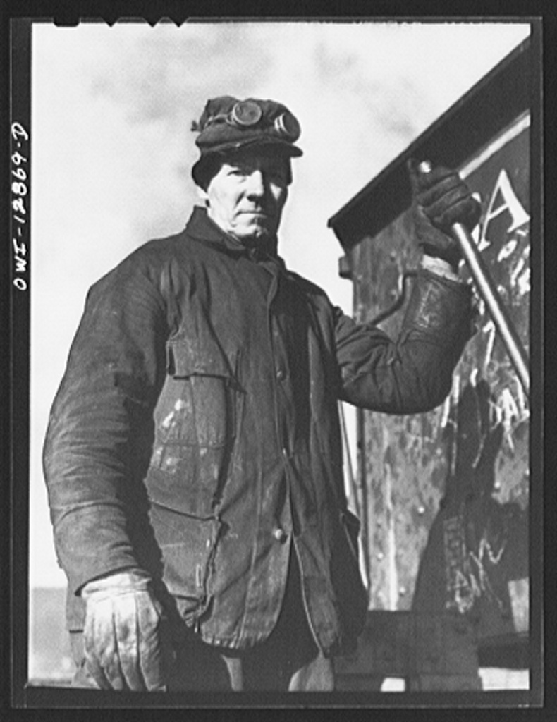 Chicago, Illinois. Worker who is employed at the rip tracks of the Chicago and Northwestern Railroad