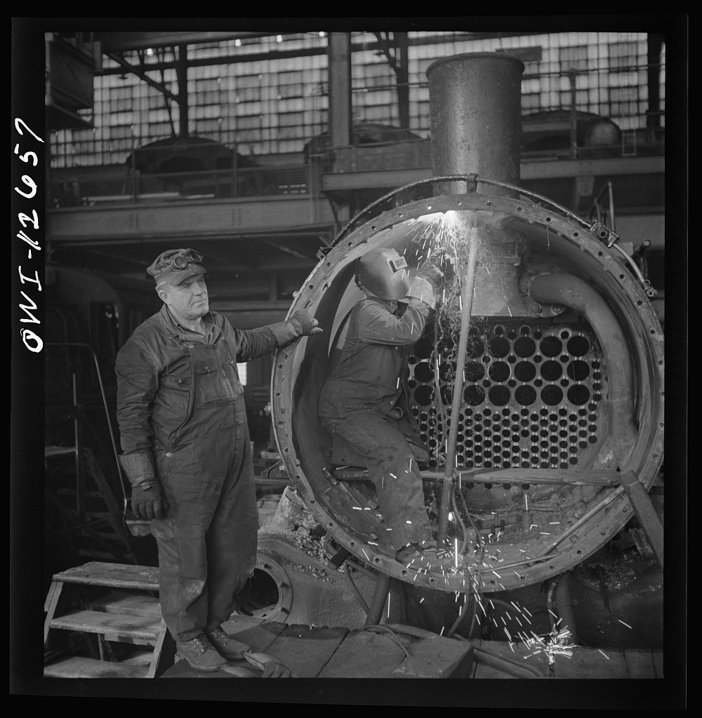 Chicago, Illinois. Working on a locomotive at the Chicago and Northwestern Railroad shops
