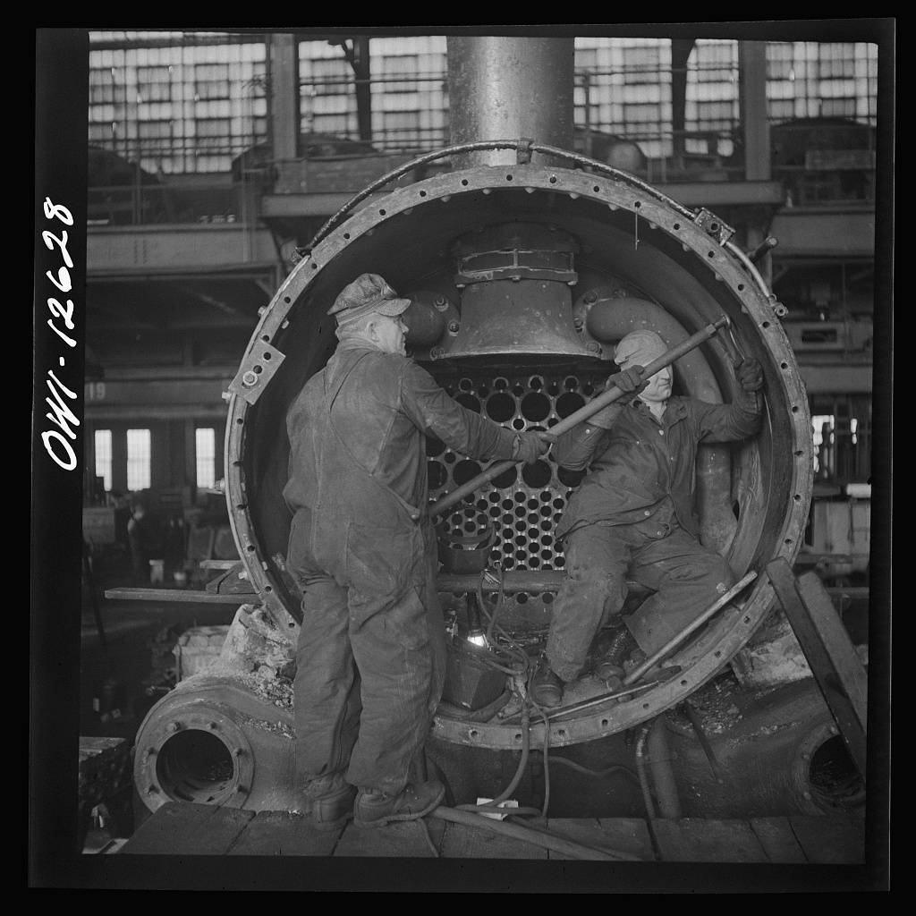 Chicago, Illinois. Working on a locomotive at the Chicago and Northwestern Railroad repair shops