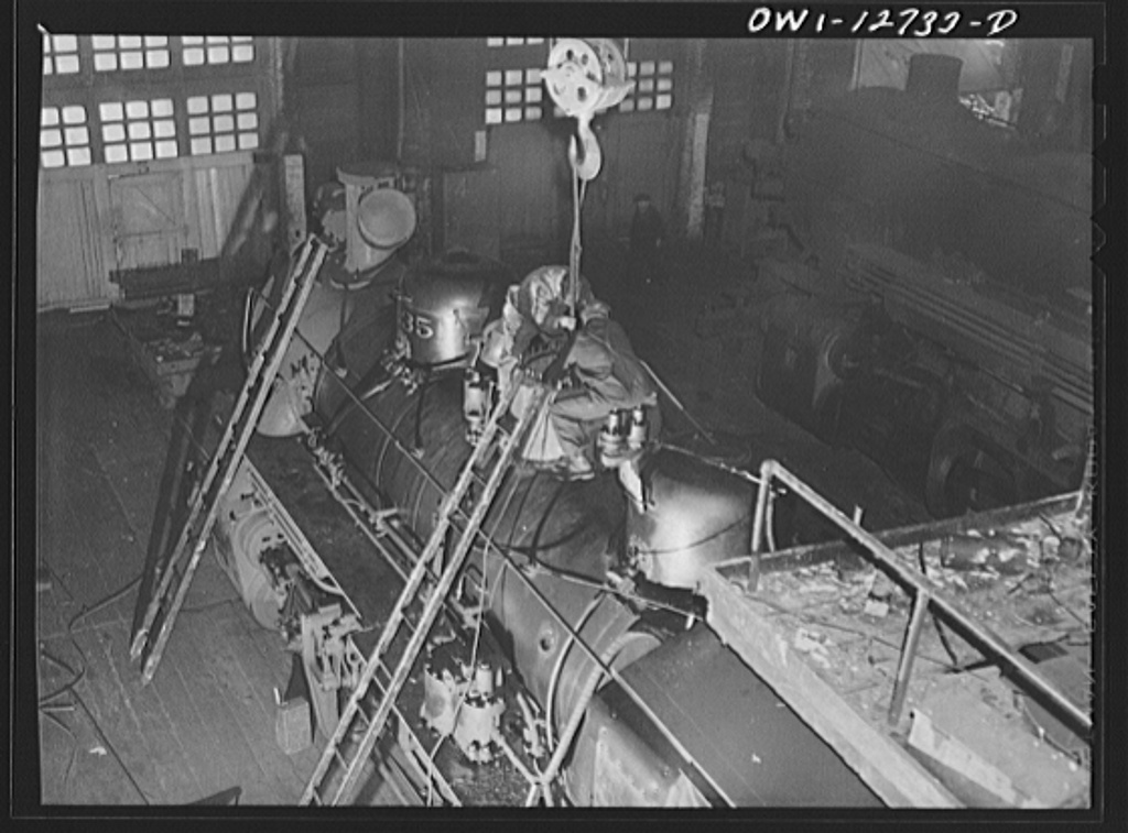 Chicago, Illinois. Working on a locomotive at the Chicago and Northwestern Railroad locomotive repair shops