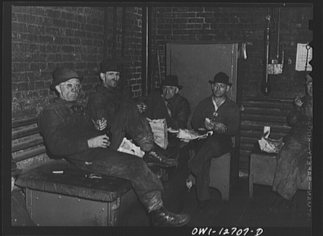 Chicago, Illinois. Workmen at the Chicago and Northwestern Railroad's locomotive shops during their half-hour lunch period