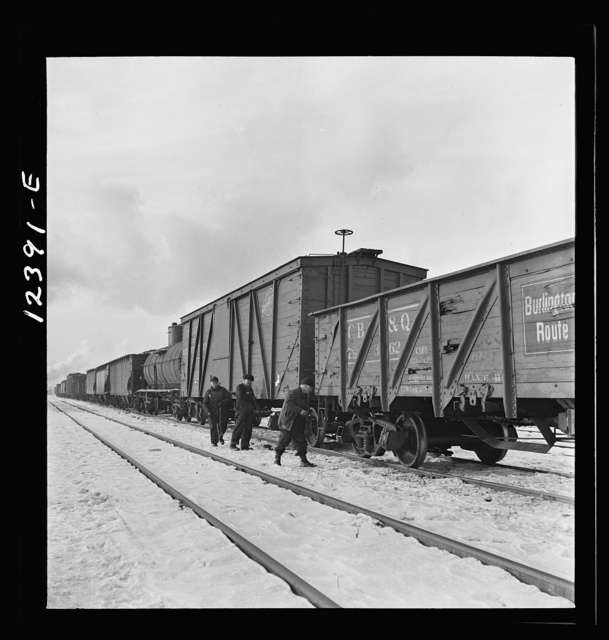 Chicago, Illinois. Workmen going out to inspect journal boxes, brakes, etc. at a Chicago and Northwestern Railroad yard