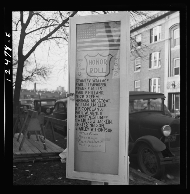 Chicago (north), Illinois. A list of men in the block who are in the armed forces, posted on a flag pole erected by the block office of civilian defense group
