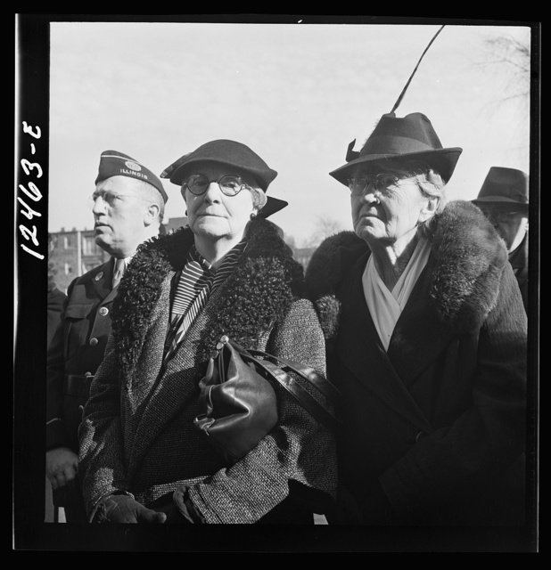 Chicago (north), Illinois. People listening to speakers at a flag dedication ceremony