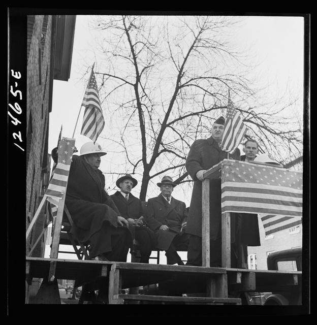 Chicago (north), Illinois. Speakers at a neighborhood flag dedication ceremony