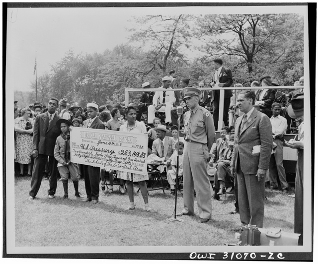 Chicago schoolchildren buy 263,148.83 in war bonds. In a specialwWar bond Campaign which ended last month, the public school children of the South-Central District of Chicago purchased 263,148.83 in war bonds and stamps. The campaign was climaxed with a rally in Washington Park on June fourth, at which time a huge check representing enough money for 125 jeeps, two pursuit planes and motorcycle was presented to Major C. Udell Turpin of the Illinois War Bond Sales staff, representing the Treasury Department. Also participating in the excercises were representatives of the War Department