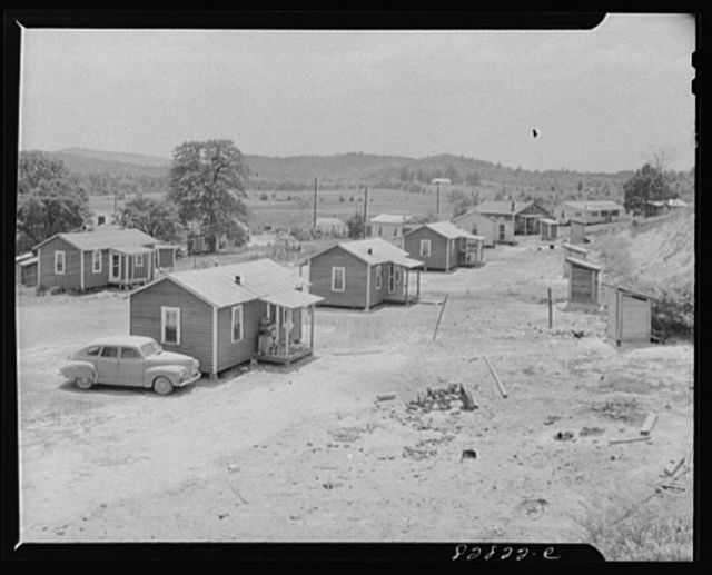 Childersburg, Alabama. Shack village built to accomodate defense workers who each pay thirty to forty dollar a month rental