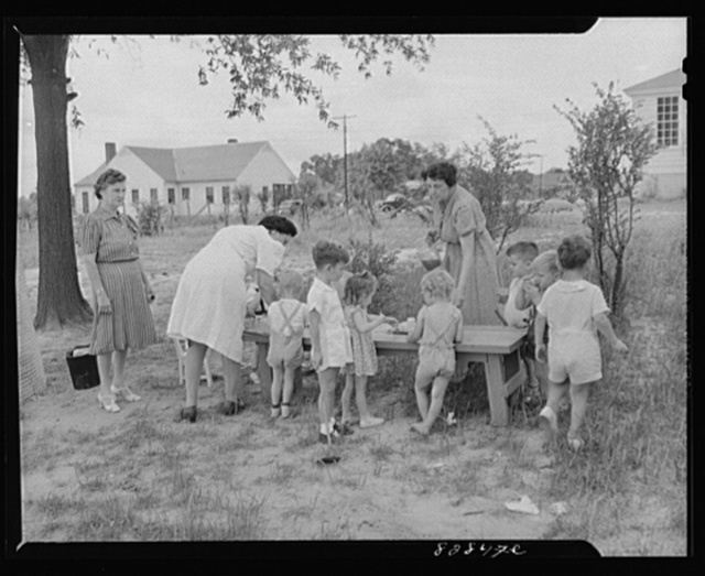 Childersburg, Alabama. Tomato juice is served to the children at 10 a.m. in the WPA (Works Progress Administration) day nursey for defense workers' children